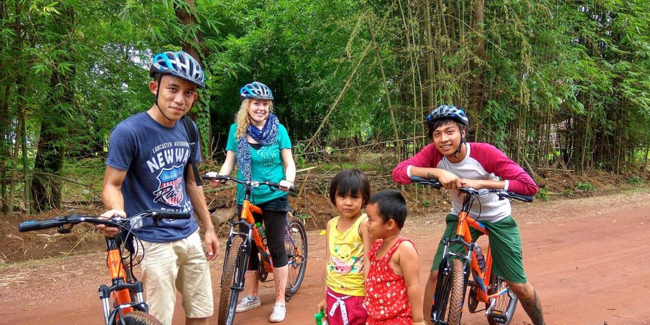 https://takemetomyanmar.com/wp-content/uploads/2019/07/Mountain-bikers-with-children-in-Hpa-an-1280x640.jpg